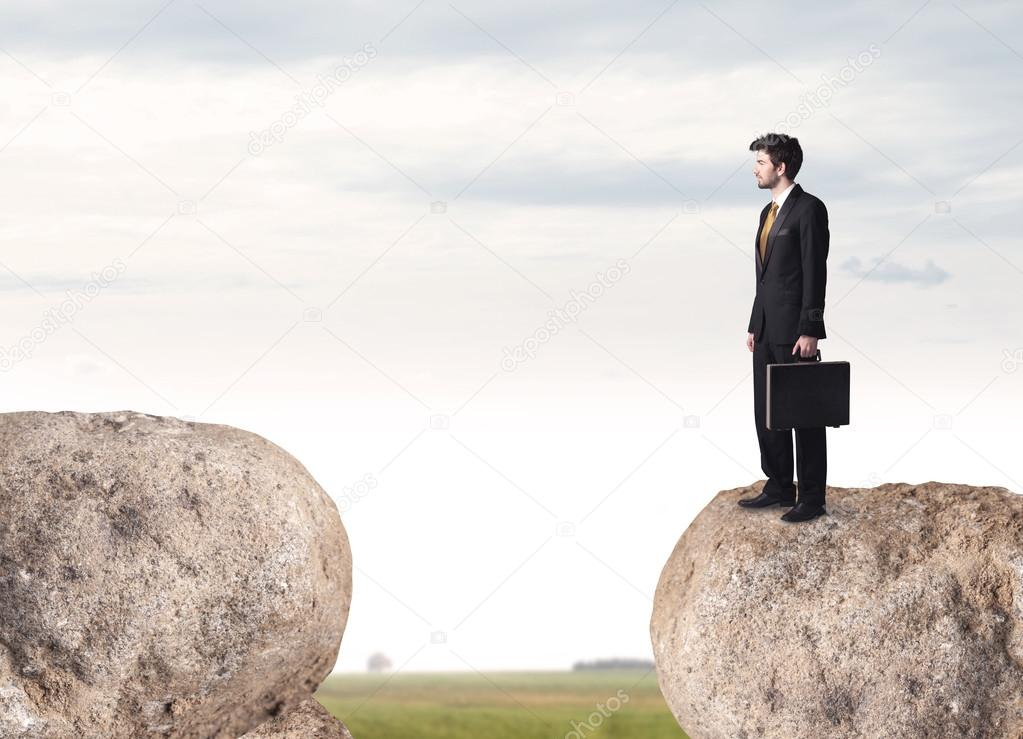 Businessman on rock mountain