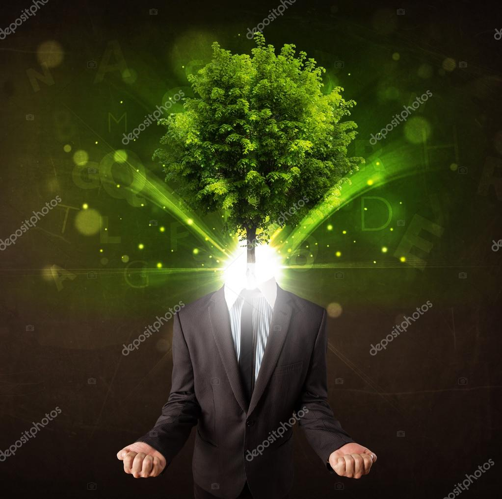 Man with green tree head concept