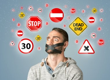 Young man with taped mouth and traffic signals around his head stock vector