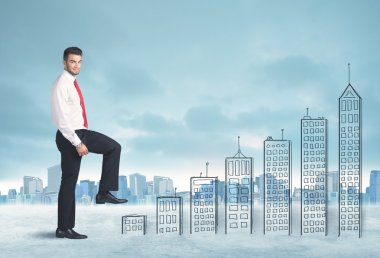 Business man climbing up on hand drawn buildings in city