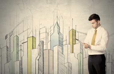Businessman standing with drawn cityscape