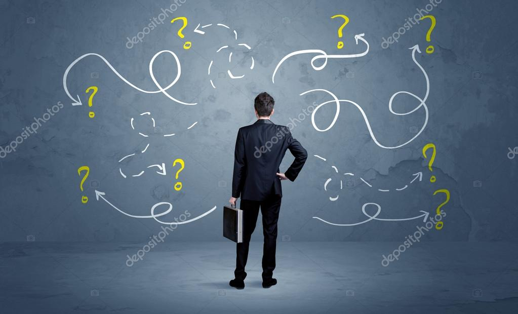 Unsure businessman with question marks