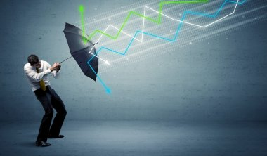 Business person with umbrella and stock market arrows concept