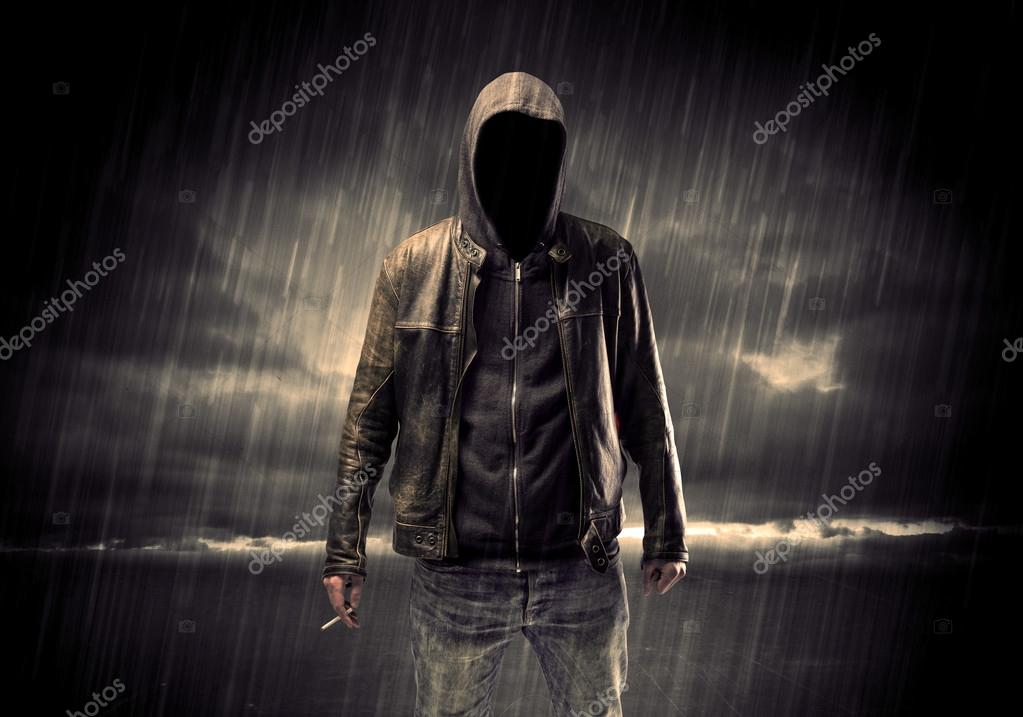 Anonymous terrorist in hoodie at night