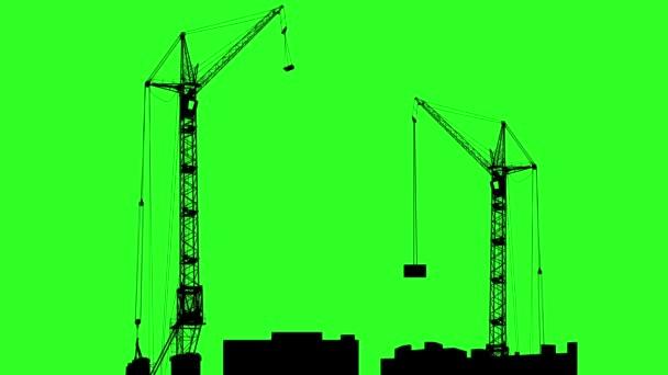 Siluety dvou jeřábů, pracující na stavbě. Zelené pozadí. animace