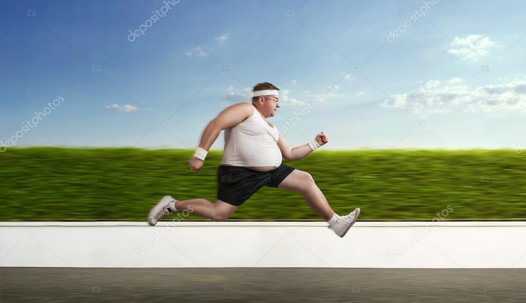 Funny overweight sportsman on the run — Stockfoto #52954753