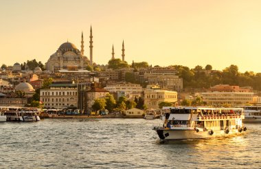Tourist boat sails on the Golden Horn in Istanbul