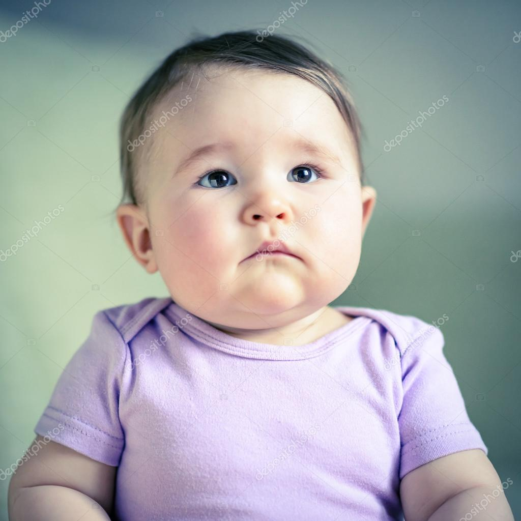 thoughtful and serious nice baby closeup — stock photo © scaliger