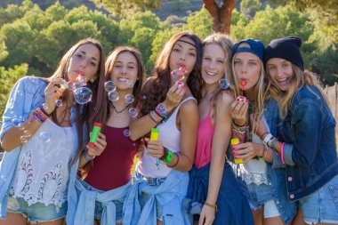 group of teens blowing bubbles