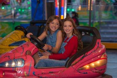 kids at fair ground riding bumper cars