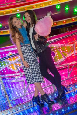 girls at the fair with candy floss