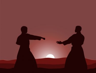 Two men are engaged in karate at sunset the sun.