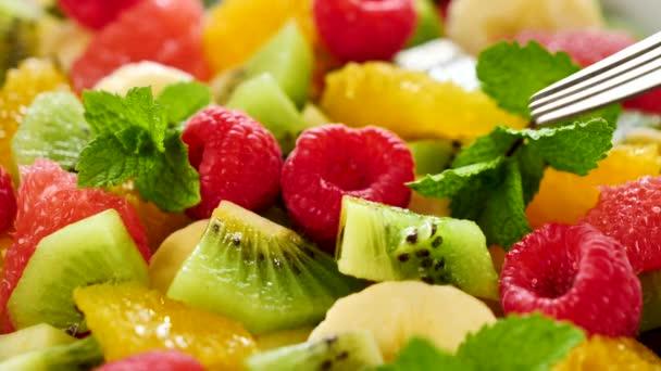 eating fresh fruit salad