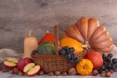 Pumpkins apples and nuts