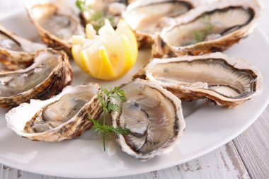 Fresh Oysters on wooden table