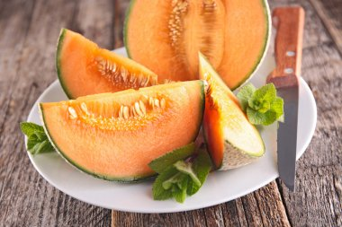 Sliced melons with mint