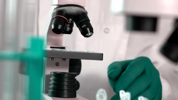 Researcher Working in Lab With Microscope.researcher in biochemical lab