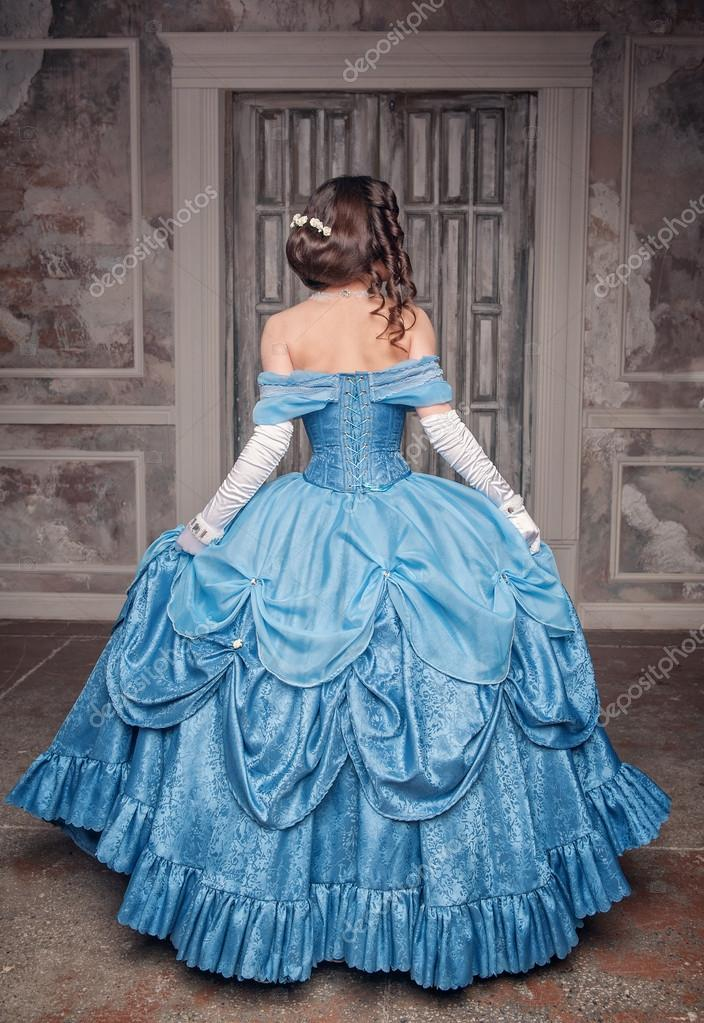 Beautiful medieval woman in blue dress, back