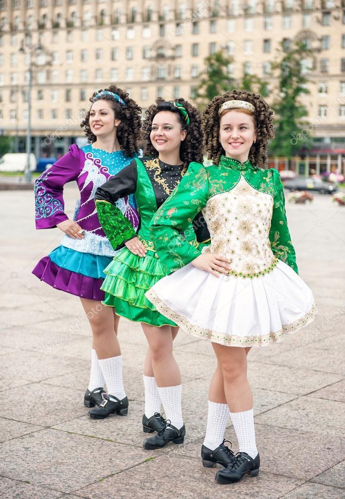 Three women in irish dance dresses posing — Stock Photo © DarkBird ... 0e83d4ad4