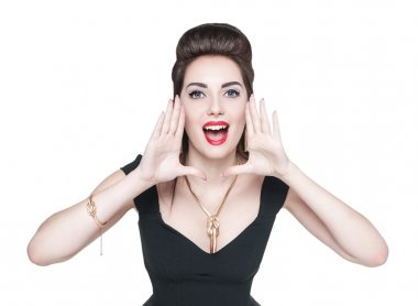 Young woman in retro pin up style shouting through megaphone sha