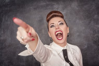 Angry screaming woman in white blouse pointing out