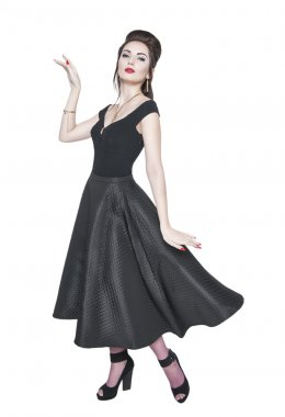 Young beautiful woman in retro pin-up style with fluttering dres