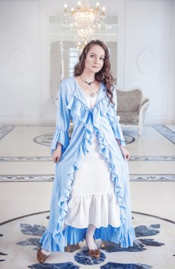 Beautiful young woman in dressing gown with frill