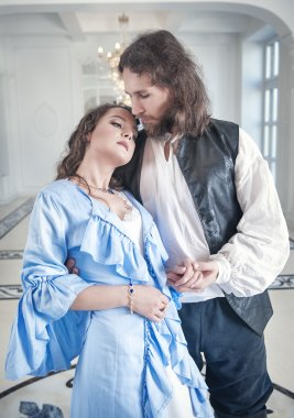 Romantic couple woman and man in medieval clothes