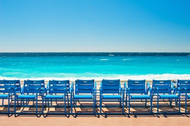 Blue chairs on the Promenade des Anglais in Nice, France