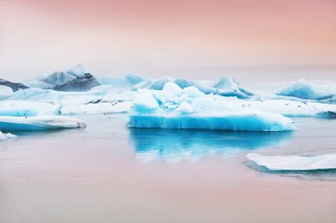 Blue icebergs in Jokulsarlon glacial lagoon