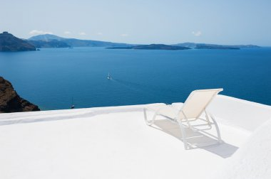 Deck chair on the terrace with sea view.