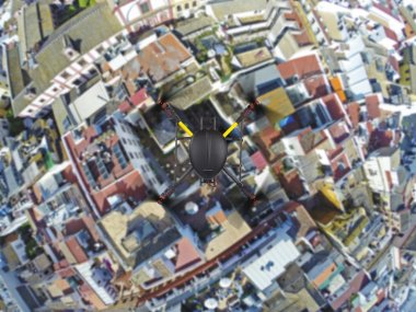 Quadcopter flying over roofs