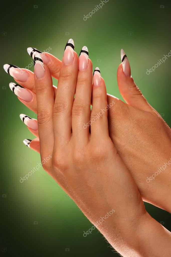 Nail design . Manicure nail paint . beautiful female hand with ...