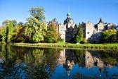 Fotografie Schloss Bueckeburg reflektiert in den Graben