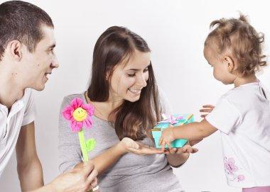Little daughter and dad congratulate mum