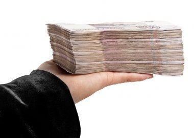 A stack of paper money on women's hand