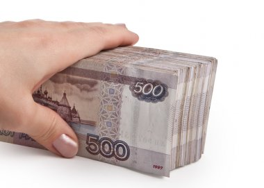 Female hand holding a pack of Russian paper money