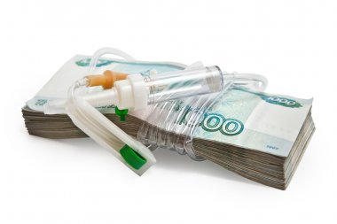 Paid medicine. A pack of Russian money tied system-the drip chamber for infusion.