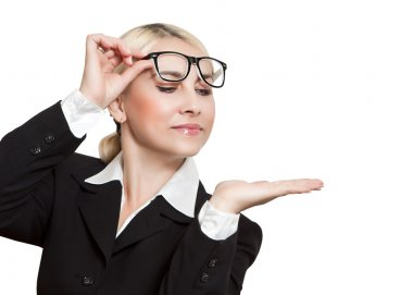 Business girl with raised glasses looks at open palm of the hand
