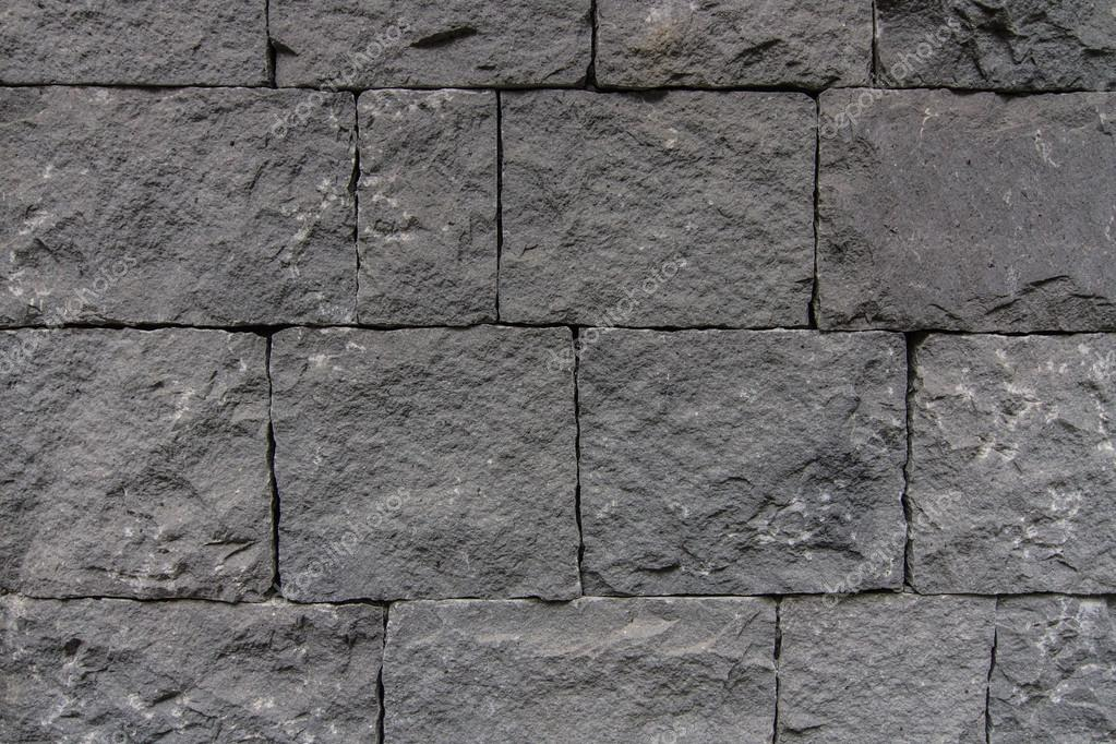 Black Basalt Stone Wall : Wall background of volcanic basalt stone texture — stock