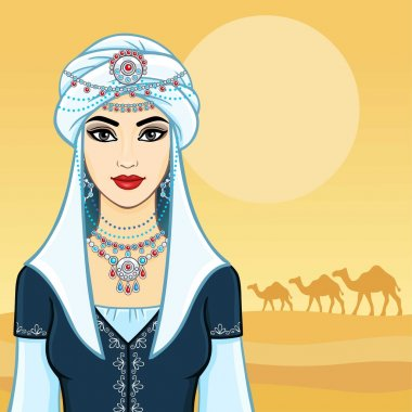 The young beautiful woman in a white turban and silver jewelry. Background - the desert, a caravan of camels.
