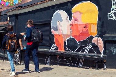 Mural artwork of Putin and Trump kissing