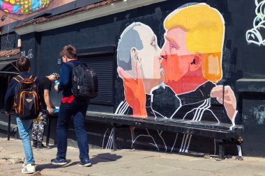 Mural artwork of Putin and Trump kissing