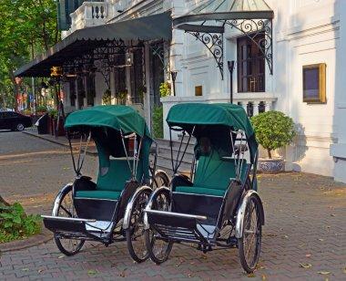 Cyclos outside Sofitel Metropole Hotel in Hanoi