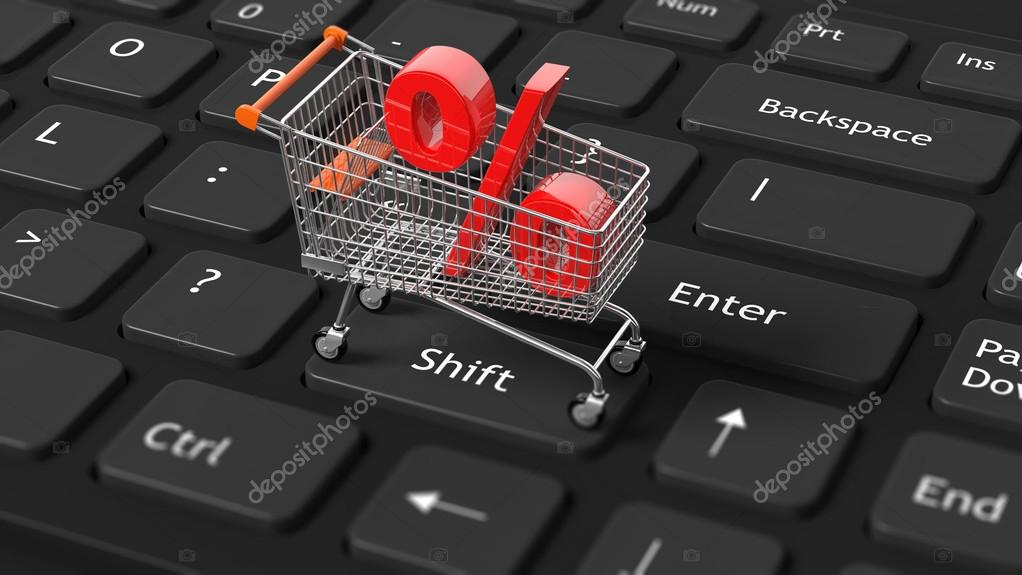 Close Up Of Shopping Cart With Red Percent Symbol On Keyboard