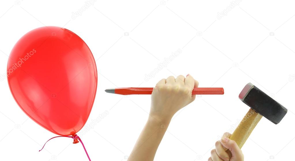 chisel and hammer about to pop a balloon isolated on white stock
