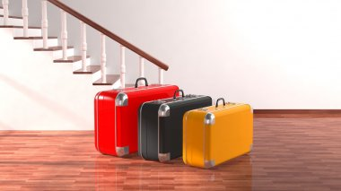 Suitcases beside stairs with white blank wall for copy-space