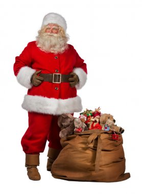 Santa Claus posing near a bag