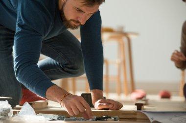Man Putting  Self Assembly Furniture