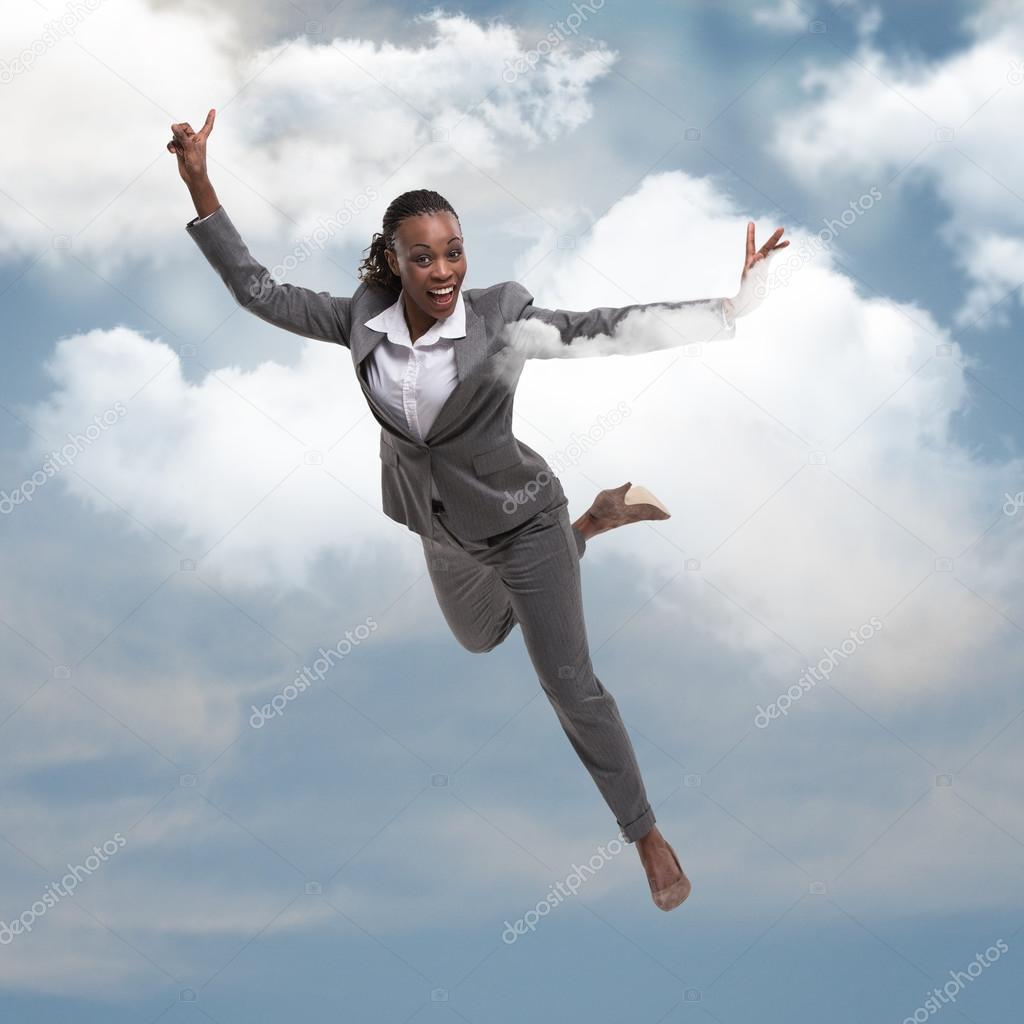 Pretty African Businesswoman Flying In The Sky And Clouds Successful Business Dreaming Concept Photo By HASLOO